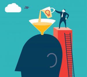 Illustration: Gehirn wird mit Wissen gefüllt